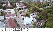 Купить «Aerial panoramic view of modern cityscape of Kaluga on banks of Oka river overlooking black domes of Holy Trinity Cathedral», видеоролик № 32251715, снято 2 мая 2019 г. (c) Яков Филимонов / Фотобанк Лори