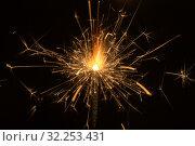 Купить «Sparks on black background close up», фото № 32253431, снято 29 сентября 2015 г. (c) Argument / Фотобанк Лори