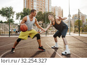 Two players in the center of basketball field. Стоковое фото, фотограф Tryapitsyn Sergiy / Фотобанк Лори