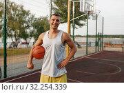 Купить «Muscular basketball player on outdoor court», фото № 32254339, снято 13 июня 2019 г. (c) Tryapitsyn Sergiy / Фотобанк Лори
