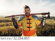 Купить «Medieval knight with axe poses in armor», фото № 32254851, снято 5 июля 2019 г. (c) Tryapitsyn Sergiy / Фотобанк Лори
