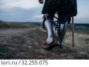 Купить «Medieval knight legs in metal armor, back view», фото № 32255075, снято 5 июля 2019 г. (c) Tryapitsyn Sergiy / Фотобанк Лори