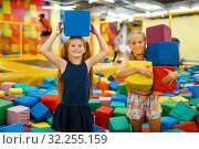Купить «Two little girls playing with soft cubes, playroom», фото № 32255159, снято 30 июля 2019 г. (c) Tryapitsyn Sergiy / Фотобанк Лори