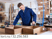 Man practising his skills with drilling machine at workshop. Стоковое фото, фотограф Яков Филимонов / Фотобанк Лори