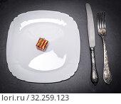 Купить «White square plate and iron cutlery on black background, top view.», фото № 32259123, снято 6 ноября 2017 г. (c) easy Fotostock / Фотобанк Лори
