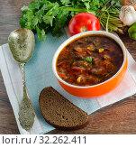 Купить «Bowl of traditional soup Borscht on table», фото № 32262411, снято 8 сентября 2017 г. (c) Elnur / Фотобанк Лори