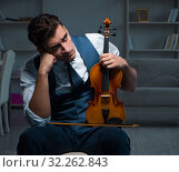 Купить «Young musician man practicing playing violin at home», фото № 32262843, снято 15 августа 2017 г. (c) Elnur / Фотобанк Лори