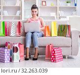 Купить «Young woman after shopping with bags», фото № 32263039, снято 2 июня 2017 г. (c) Elnur / Фотобанк Лори