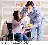 Купить «The young family taking care of each other», фото № 32264243, снято 10 апреля 2017 г. (c) Elnur / Фотобанк Лори