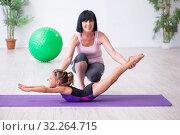 Купить «Girl and mother exercising at home», фото № 32264715, снято 16 июля 2019 г. (c) Elnur / Фотобанк Лори