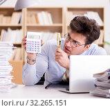 Купить «Mad auditor looking for errors in the report», фото № 32265151, снято 20 января 2017 г. (c) Elnur / Фотобанк Лори