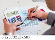 Купить «Finance analyst looking and financial reports», фото № 32267583, снято 2 марта 2017 г. (c) Elnur / Фотобанк Лори