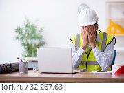 Купить «Young male architect working in the office», фото № 32267631, снято 1 августа 2019 г. (c) Elnur / Фотобанк Лори