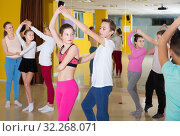 Купить «Children dancing rock-and-roll in pairs in choreography class wi», фото № 32268071, снято 3 марта 2018 г. (c) Яков Филимонов / Фотобанк Лори