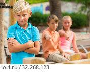 Portrait of boy 8-11 years old which is taking offense on his friends. Стоковое фото, фотограф Яков Филимонов / Фотобанк Лори