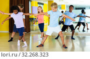 Купить «boys and girls dancing rock-and-roll in pairs with female trainer», фото № 32268323, снято 31 июля 2019 г. (c) Яков Филимонов / Фотобанк Лори