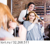 Купить «Model is showing to haircutter at what length to cut hair.», фото № 32268511, снято 7 марта 2017 г. (c) Яков Филимонов / Фотобанк Лори