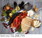 Купить «Still life with tasty seafood, wine, cheese and bread», фото № 32268715, снято 10 февраля 2018 г. (c) Яков Филимонов / Фотобанк Лори