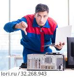 Купить «The computer repairman specialist repairing computer desktop», фото № 32268943, снято 19 января 2018 г. (c) Elnur / Фотобанк Лори