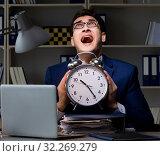 Купить «Employee staying late to finish work on auditing», фото № 32269279, снято 21 декабря 2017 г. (c) Elnur / Фотобанк Лори