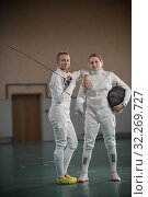 Купить «A portrait of two young women fencers looking at the camera», фото № 32269727, снято 5 октября 2019 г. (c) Константин Шишкин / Фотобанк Лори