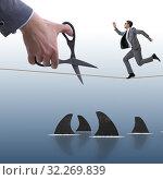 Купить «Hand cutting rope in business risk concept», фото № 32269839, снято 21 ноября 2019 г. (c) Elnur / Фотобанк Лори