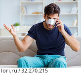 Купить «Young man recovering healing at home after plastic surgery nose», фото № 32270215, снято 26 июля 2017 г. (c) Elnur / Фотобанк Лори