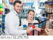 Купить «Happy man and woman using palette scheme», фото № 32270755, снято 17 мая 2018 г. (c) Яков Филимонов / Фотобанк Лори