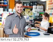 Купить «Man with purchases in household store», фото № 32270763, снято 17 мая 2018 г. (c) Яков Филимонов / Фотобанк Лори