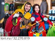 Купить «Young happy enjoying new tourist equipment», фото № 32270819, снято 8 марта 2017 г. (c) Яков Филимонов / Фотобанк Лори