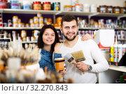 Купить «Couple examining various painting brushes», фото № 32270843, снято 9 марта 2017 г. (c) Яков Филимонов / Фотобанк Лори