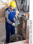 Купить «Plasterer is ready to plaster the walls at the object.», фото № 32270923, снято 3 июня 2017 г. (c) Яков Филимонов / Фотобанк Лори