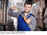 Positive construction man showing various tools. Стоковое фото, фотограф Яков Филимонов / Фотобанк Лори
