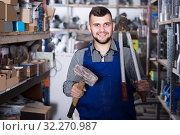 Man shows a different working tool. Стоковое фото, фотограф Яков Филимонов / Фотобанк Лори