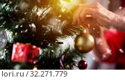 Купить «senior woman decorating christmas tree», видеоролик № 32271779, снято 13 ноября 2019 г. (c) Syda Productions / Фотобанк Лори