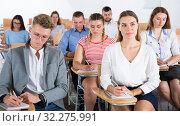Купить «Group of people in lecture hall», фото № 32275991, снято 25 июля 2018 г. (c) Яков Филимонов / Фотобанк Лори