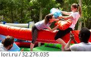 Купить «Pillow fight between girlfriends in an amusement park», фото № 32276035, снято 16 декабря 2019 г. (c) Яков Филимонов / Фотобанк Лори