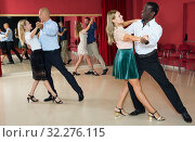 Купить «People learning to dance waltz», фото № 32276115, снято 4 октября 2018 г. (c) Яков Филимонов / Фотобанк Лори