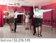 Купить «Couples enjoying latin dances», фото № 32276135, снято 4 октября 2018 г. (c) Яков Филимонов / Фотобанк Лори