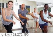 Купить «Group of multinational smiling people enjoying new dance techniques», фото № 32276195, снято 30 июля 2018 г. (c) Яков Филимонов / Фотобанк Лори