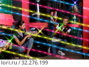 Купить «Group portrait of fine people with laser guns», фото № 32276199, снято 23 августа 2018 г. (c) Яков Филимонов / Фотобанк Лори