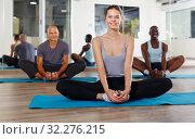 Купить «People doing stretching exercises», фото № 32276215, снято 30 июля 2018 г. (c) Яков Филимонов / Фотобанк Лори