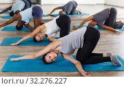 Купить «Group of active adult women and men exercising stretching workout», фото № 32276227, снято 30 июля 2018 г. (c) Яков Филимонов / Фотобанк Лори