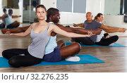 Купить «females and males doing stretching workout in pairs», фото № 32276235, снято 30 июля 2018 г. (c) Яков Филимонов / Фотобанк Лори