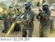 Купить «Two vigorous paintball players in full gear having fun outdoors», фото № 32276291, снято 22 сентября 2018 г. (c) Яков Филимонов / Фотобанк Лори