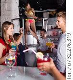 Купить «Female and male clubbing with cocktail in the club on party», фото № 32276319, снято 28 августа 2017 г. (c) Яков Филимонов / Фотобанк Лори