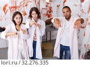 Купить «Young people posing as zombies», фото № 32276335, снято 8 октября 2018 г. (c) Яков Филимонов / Фотобанк Лори