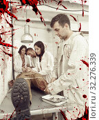 Купить «Young adults in escape room with traces of blood», фото № 32276339, снято 8 октября 2018 г. (c) Яков Филимонов / Фотобанк Лори