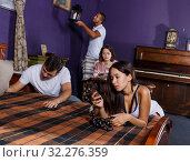 Купить «Young adults inspecting wooden rosary in escape room», фото № 32276359, снято 8 октября 2018 г. (c) Яков Филимонов / Фотобанк Лори