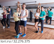 Купить «Active adults dancing salsa together in dance studio», фото № 32276375, снято 23 октября 2019 г. (c) Яков Филимонов / Фотобанк Лори